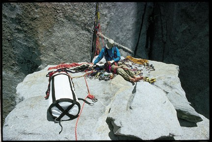 Organizing gear on El Cap Spire, one on the most killer locations on T...