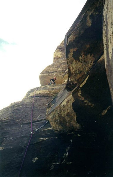 Looking up at a climber on pitch 4.