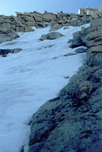 Looking up the Mountaineers Route above the notch with summit plateau ...