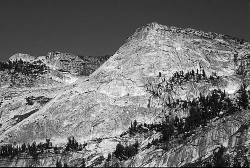 A side profile of Tenaya Peak with Tenaya Lake below.
