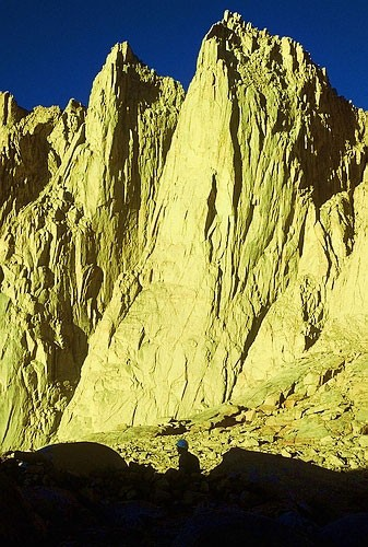 This is the east face of Keeler Needle at sunrise as a climber prepare...