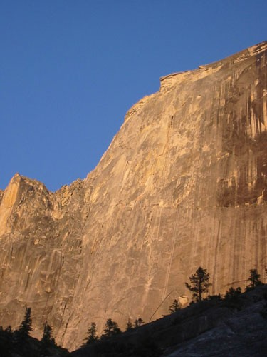 Half Dome as seen from the approach with warm evening light.