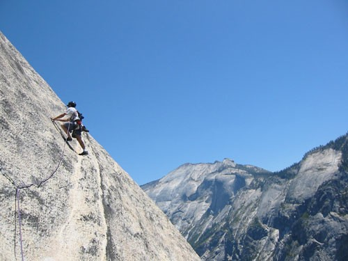 Chris McNamara on pitch 8 of Crest Jewel with Tenaya Canyon in the bac...