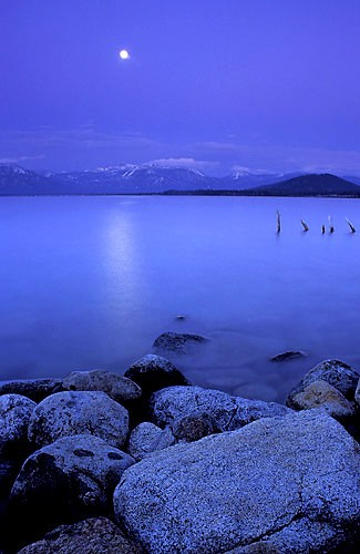 Full moon above Lake Tahoe at dusk.