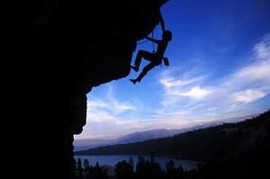 Kevin Swift climbing Huntin' Gator at Mayhem Cove. Lake Tahoe is in th...