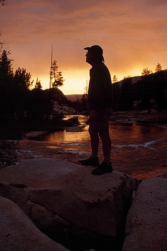 Jim Langford enjoys the amazing colors of a sunset at the north fork o...