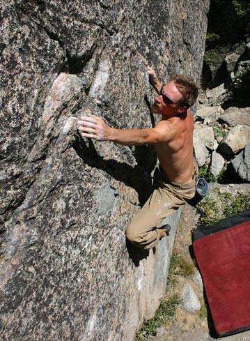 Kevin Swift on a V2 crack/face at the top of Snowshed Wall.