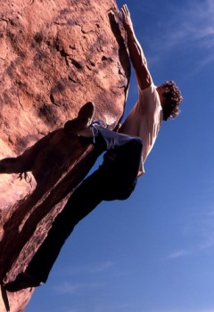 John Long fires a dyno while bouldering in tennis shoes, Willow Spring...