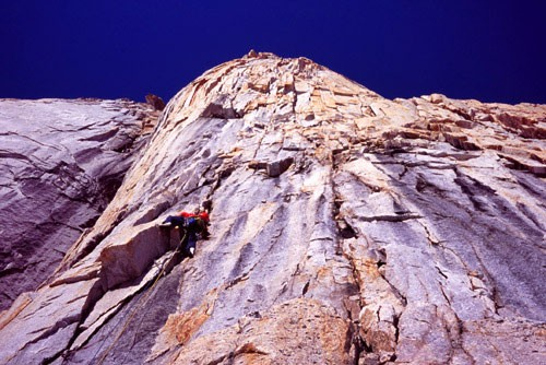 Chris McNamara leading the crux 5.10c 14th pitch of the West Pillar of...