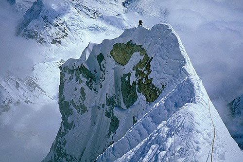 Mark Westman climbing along the knife-edge ridge section of Mt. Forake...