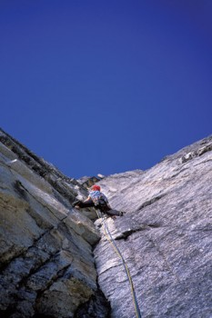 Joe Puryear leading another splitter granite pitch on the first ascent...
