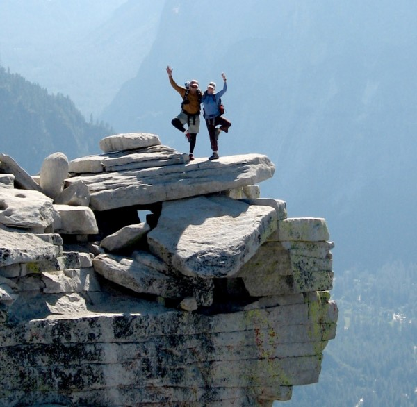 Photo opportunity on Half Dome's diving board, following climbing Snak...