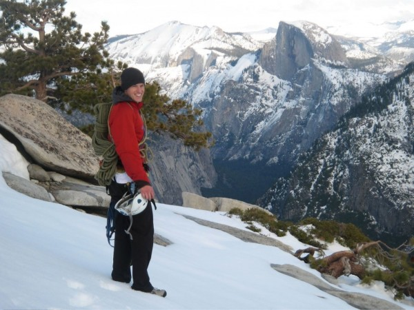 Chris McNamara on the snowy descent with Half Dome in the background.