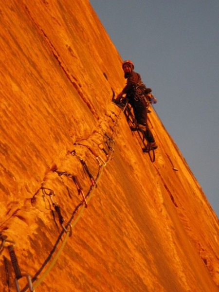 Ammon McNeely on the crux pitch at sunrise on Rodeo Queen. I promise t...