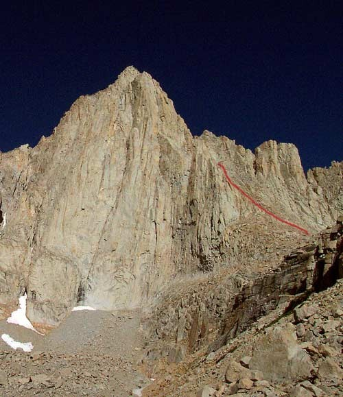 The route disappears behind the ridge and follows the gully to the sum...