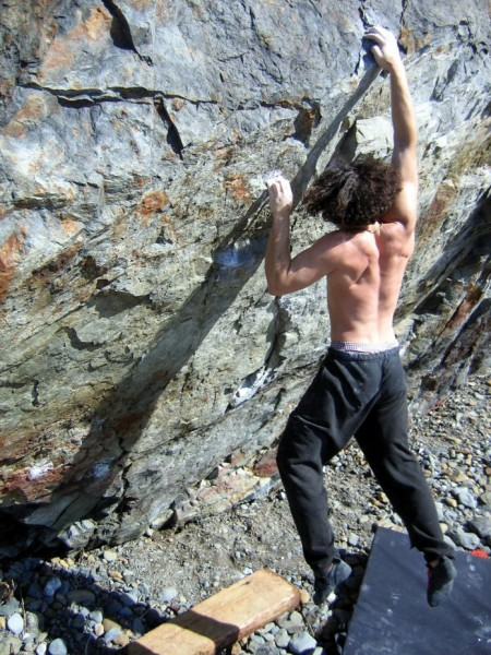 Charlie Barrett clings onto Manitou (V11).