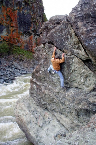 Marcos Nunez high over the Russian River on Cracker (V0R/X).