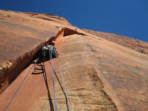 Ammon McNeely on crux pitch of Cosmic Trauma using the Yates Speed Aid...