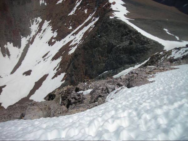 View looking down from high on the Dana Couloir on 6-22. Note snow in ...