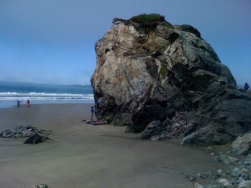 Climbers on The Old Man Boulder at Stinson Beach in April.