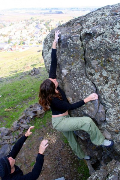 Brooke Ferguson does a V0 on the Stonewall.