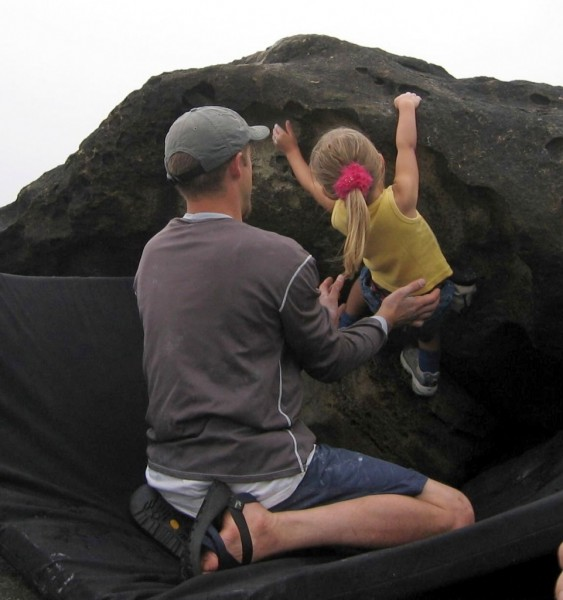 Chris spots Holly on one of her first boulder problems!