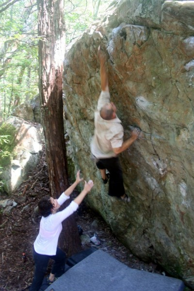 Elizabeth Brand spots Rob Bianco on a dyno variation to Intuition
