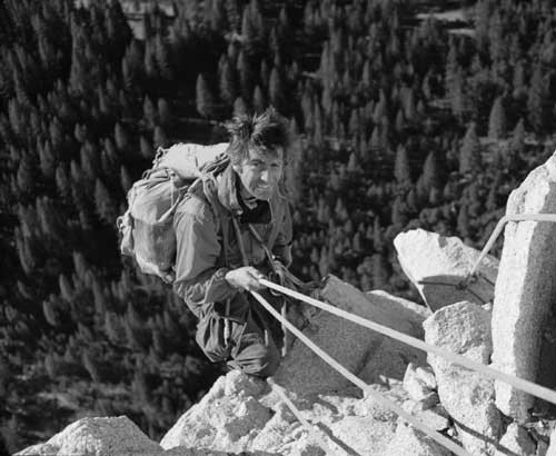 Warren Harding rappelling from Dolt Tower during the first ascent of T...
