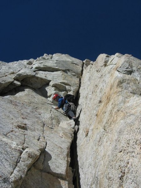 Eric Volz leading the first crux on pitch 4. Wide climbing at 13,000 f...