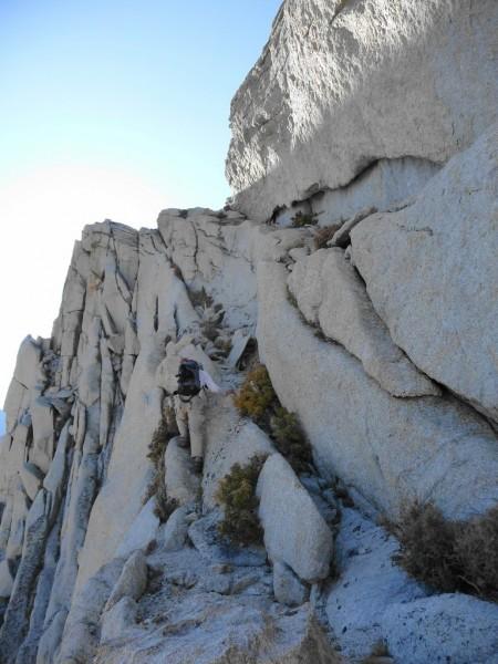 Me scrambling up to Thor Peak's summit plateau