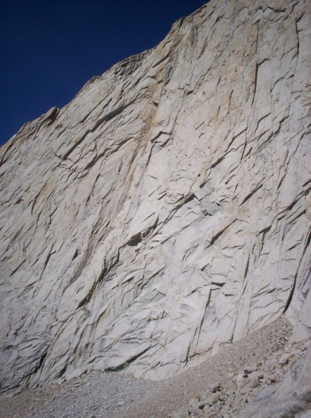 Harding route: two climber barely visible just below reddish dihedral ...