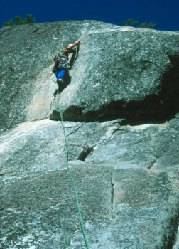 Barbara Tonnieshen preparing for the crux 5.8 mantel on pitch 5.