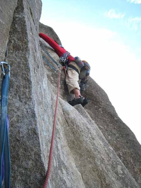 Ed Hartouni gets through the technical crux on his way to the granite ...