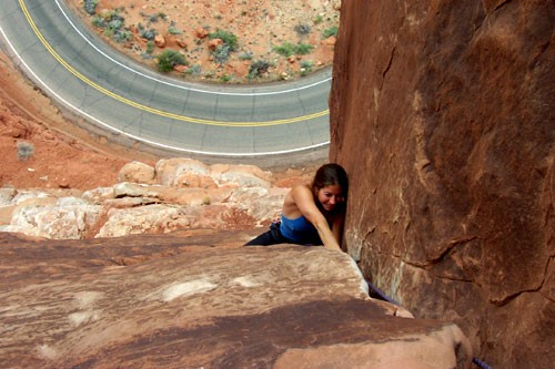 Sarah Felchlin enjoying a 5.9 fist section at the top of pitch 1.