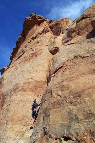 Sarah Felchlin leading pitch 3 with the summit above.