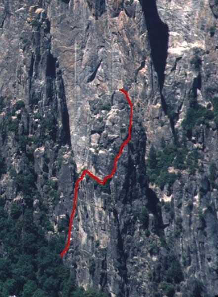 Climber on the first pitch with the route above.