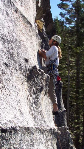 A climber on nearing the 5.5 crux on the first pitch of The Farce.
