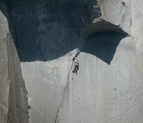 A climber on the Great Roof nearing the C2 (or 5.13) crux on The Nose....