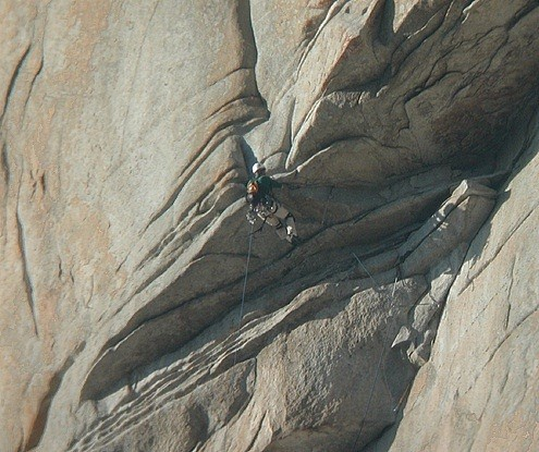 A climber turning the lip of the airy Roof on the Salath&eacute; Wall. This i...
