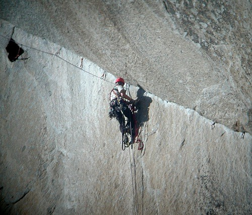 A climber cleaning the dramatic traverse on pitch 7 of The Shield. On ...