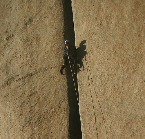 A climber in the middle of the notorius Groove Pitch during the last r...