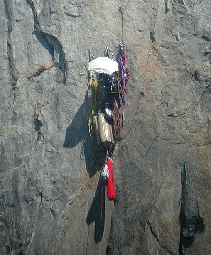 A climber at the twelfth belay on Zodiac using an umbrella for shade &...