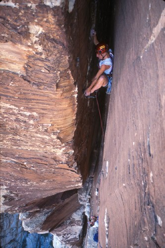 Classic North American Climbing Areas - Professional Photo Slideshow Image #1 - by Mark Kroese Roxanna Brock on one of the many chimney pitches of Epinephrine, Red Rocks, Nevada. []