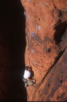 Unknown climber on a 5.10c route in the Black Corridor, Red Rocks, Nev...