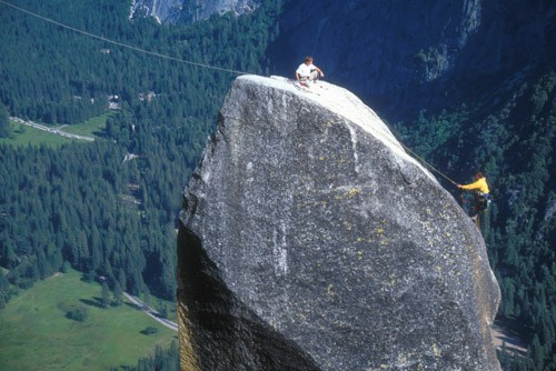 Classic North American Climbing Areas - Professional Photo Slideshow Image #5 - by Sean Courage Topping out on the Lost Arrow Spire Tip. The rope on the left leads to rim and will be used on the Tyrolean Traverse. [yblalati]