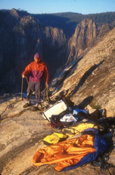 Sean Courage coiling a rope on the summit of the Zodiac, El Capitan. T...