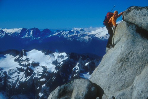 Mark Kroese bouldering near the summit of a peak in the Cascades, Wash...