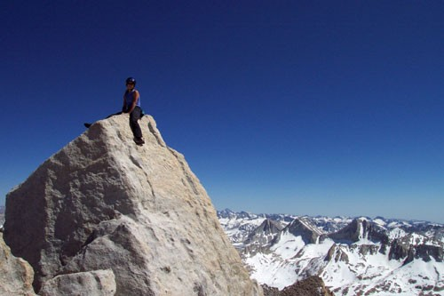 Sarah Felchin on the summit of Bear Creek Spire. The last five feet to...