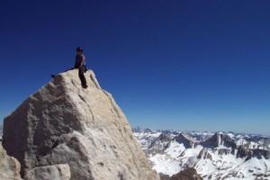 Sarah Felchin on the summit of Bear Creek Spire. The last five feet to...