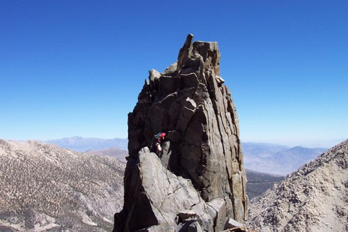 Brad Goya at the belay 7 on the First Tower on Moon Goddess Arête. Thi...